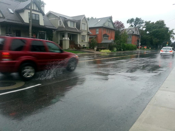 Getting splashed on Aberdeen Avenue during rainfall (RTH file photo)