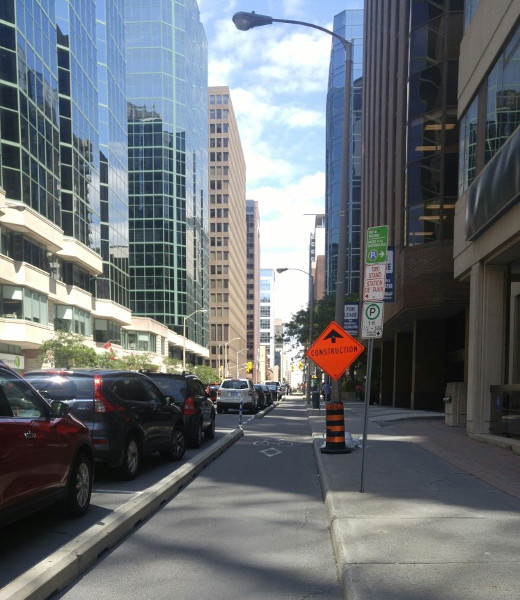 Protected bike lane with construction sign not blocking it