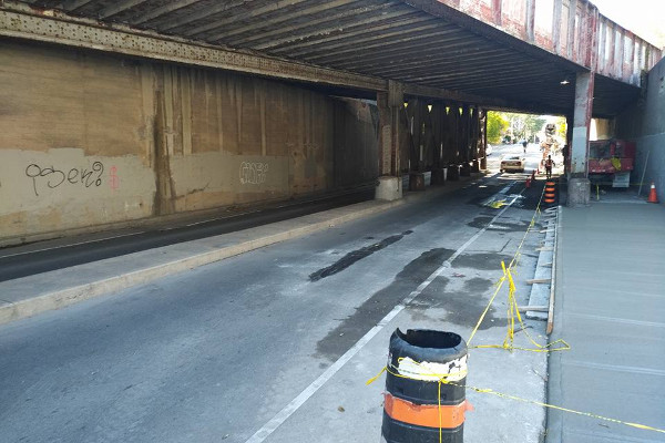 Sidewalk closed on Young through rail underpass
