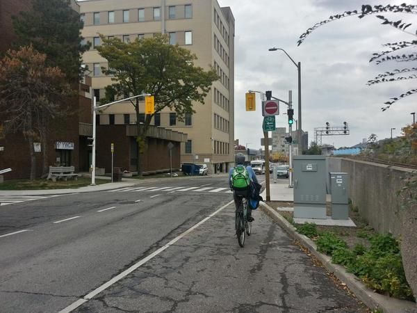 Bike Lane Ends sign blocks visibility of traffic signal