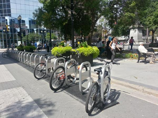 Bike share station at Gore Park, King and James, already in use as bike parking