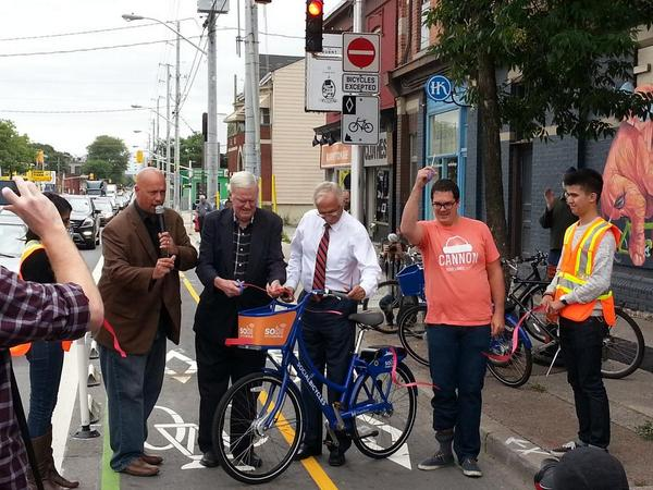 Councillor Jason Farr, Councillor Bob Morrow, Mayor Bob Bratina and Yes We Cannon coordinator Justin Jones cut the ribbon