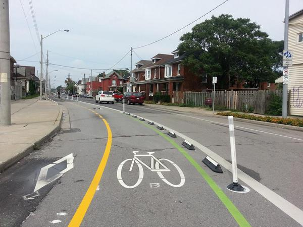 Knockdown bollards and rubber curbing on Cannon west of Sherman