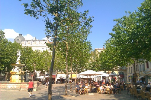 People relax in Place Carnot