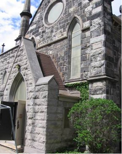 Figure 8: Church of the Ascension. Note the contrast between the grey stone of the entrance (added later and made of Eramosa dolomite) and the blackened Whirlpool sandstone used to construct the original church in 1851.
