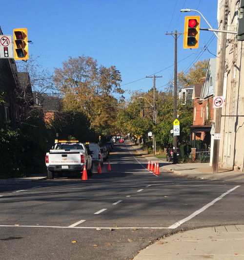 Temporary pylons placed on Charlton at Queen have been slowing vehicle speeds