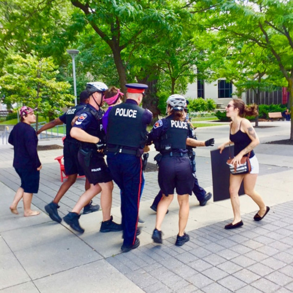 Hamilton Police arresting Woody Boychuk at the August 10, 2019 rally against hate (Image Credit: Graham Crawford)