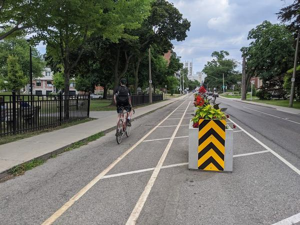 A cyclist rides on the Herkimer bike lane (RTH file photo)