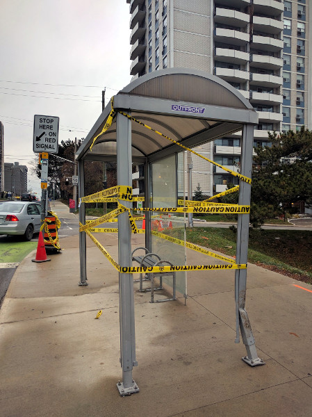 This bus shelter at Hunter and Bay was struck by a person driving a car, not a person riding a bike