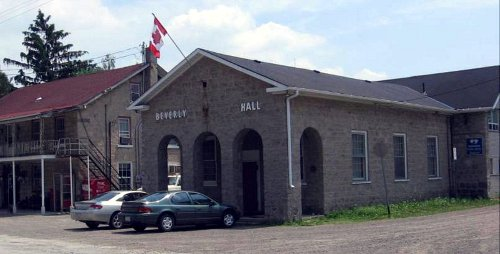 Figure 3: Beverley Hall. The building behind is The Rockton Grocery and Post Office, originally the Rockton Hotel. It is built of larger, better trimmed blocks than the Hall, and has an iron verandah, so was probably built somewhat later. The stone is Guelph dolomite from North Beverly.