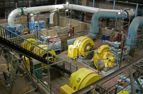 Three horizontal centrifugal pumps (yellow) with two new vertical centrifugal pumps (blue) being prepared to join them.
