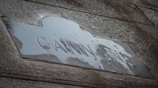 A stampted concrete sign is not enough to make Cannon welcoming to pedestrians