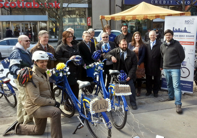 From left: Brad Tyleman, Hamilton Cycling Committee; Matthew Green, Ward 3 Councillor; Paul Miller, MPP for Hamilton East-Stoney Creek; Monique Taylor, MPP for Hamilton Mountain; Gerry Davis, Public Works General Manager; David Christopherson, MP for Hamilton Centre; Gene Wasik, Hamilton Bike Share Executive Director; Ted McMeekin, MPP for Ancaster-Dundas-Flamborough-Westdale; Sean Burak, Hamilton Bike Share Operations Manager; Peter Topalovic, Public Works Manager for transportation demand management; Jason Farr, Ward 2 Councillor; Chelsea Cox, Hamilton Bike Share Community Manager; Chris Burke, Metrolinx director of service planning; Justin Wiley, Social Bicycles Vice President of business development