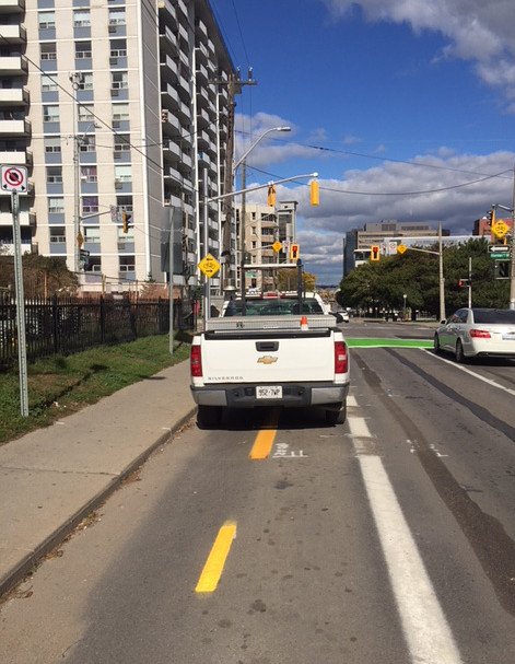 Another truck blocking Bay Street bike lanes (Image Credit: Tony Higgins)