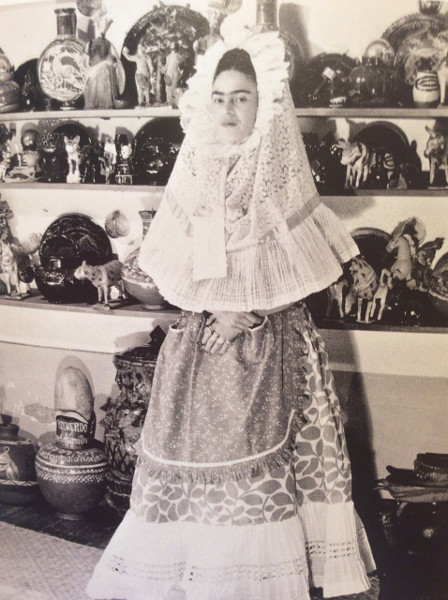 Frida, at home, in the Blue House, dressed in traditional Tehuana garb, circa 1940.