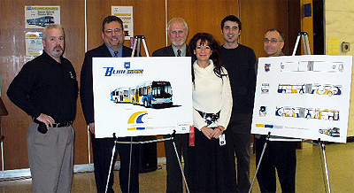Dave Kuruc (2nd from right) is congratulated for his design