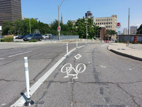 Knockdown sticks on Hunter Street bike lanes just east of Park Street