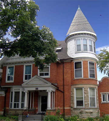 274 Bay South, 1892 Queen Anne style with conical corner tower, and varying brick and stone.