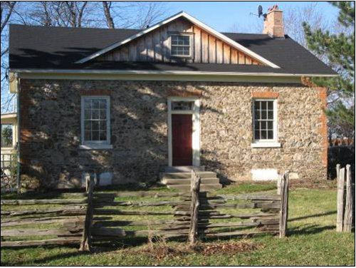 Figure 4a. The James McFarland House, at 1436 Concession 2, Niagara-on-the-Lake: built of local fieldstone in 1851 (photo by Bob Watson). Brick used for voussoirs and quoins.