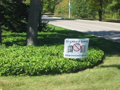 Example of lawn signs appearing frequently on Scenic Drive.