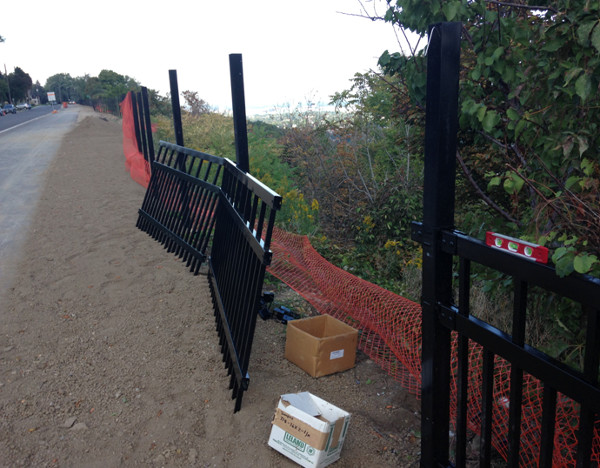 New fence beside Mountain Brow Boulevard