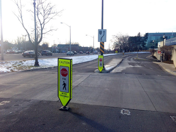 Pedestrian crossing at McMaster with sign warning drivers to yield to pedestrians