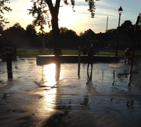 Sun setting over the splash pad