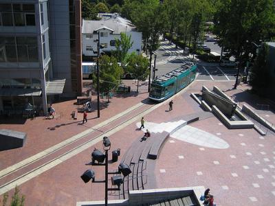 Rapid transit compatible: light rail on pedestrian plaza (Image Credit: Flickr)