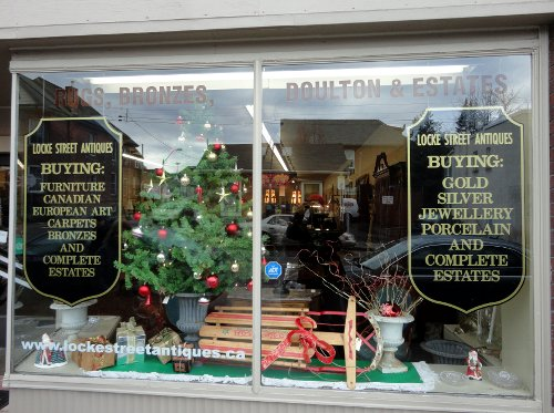 A Christmas tree in the window of Locke Street Antiques, one of the last remaining antique stores