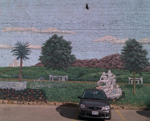 I found this mural in an alley that led to one of the many large and copious parking lots just behind the main streets