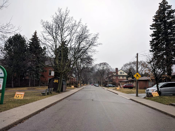 'Slow Down: Safety Zone' signs on Mapleside Avenue