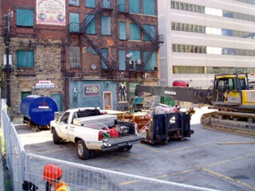 Fencing, a fuel tank and an excavator behind 18-28 King Street East (Image Credit: Eric McGuinness)