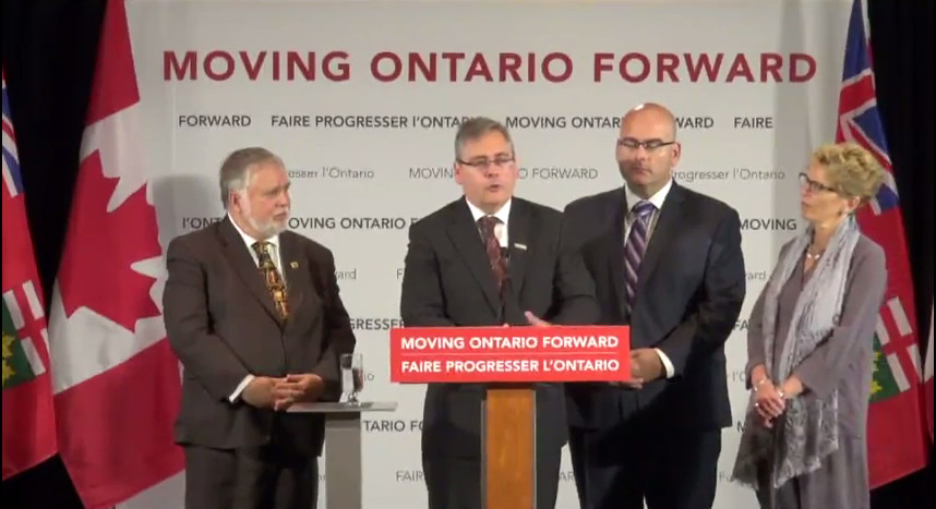 Municipal Affairs and Housing Minister Ted McMeekin, Metrolinx CEO Bruce McCuaig, Transport Minister Steven Del Duca and Premier Kathleen Wynne at the Hamilton funding announcement