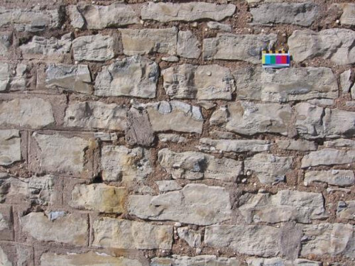 Figure 10.  Detail of the rubble stone in the front part of the Gatehouse. Note lighter coloured chert in brown dolomite. Scale in cms.
