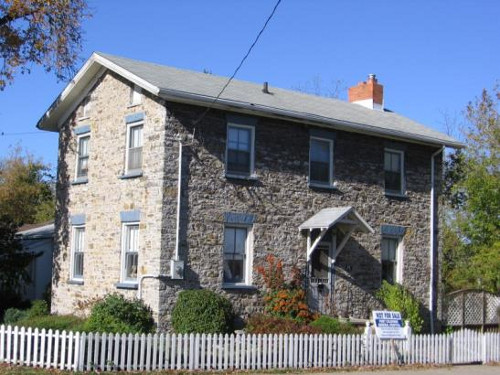 Figure 14. The Lockkeeper's House, 44 King Street, Port Colborne, was built by David Price, stonemason in 1835, and later sold by W.K. Merritt for £30. It is a fine, if simple, two story Georgian house constructed of rubblestone, consisting of blocks of white limestone with abundant dark grey chert, which was certainly quarried locally from the Devonian Bois Blanc Formation. The history is thoroughly documented in the book by David G. Anger, 2006, Port Colborne: Tales from 'The Age of Sail'. Note: the 'not for sale' sign seems unusual to me!