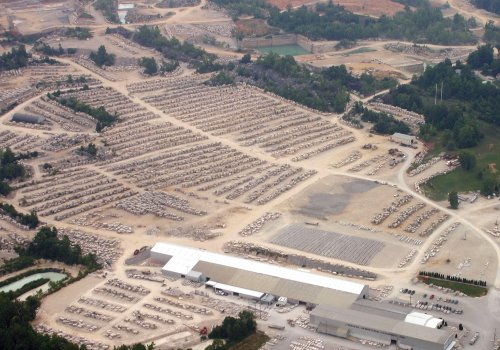 Figure 3. An aerial photograph of a modern quarry in the Indiana limestone (courtesy of the Indiana Limestone Company). The active quarry faces are behind the stone block