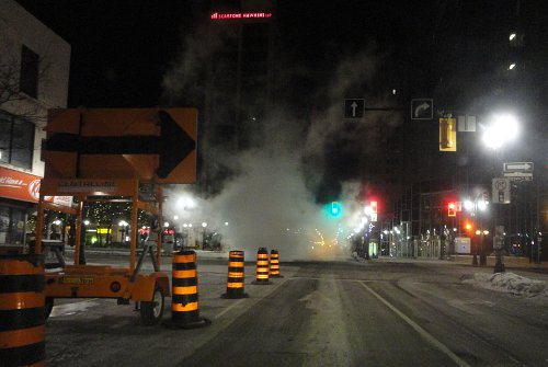 Steamy sewer work at King and James late at night on Friday, January 21