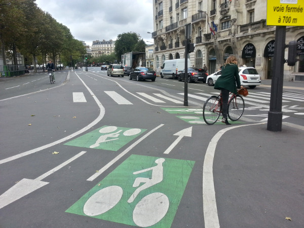 Woman riding a bike in Paris (RTH file photo)
