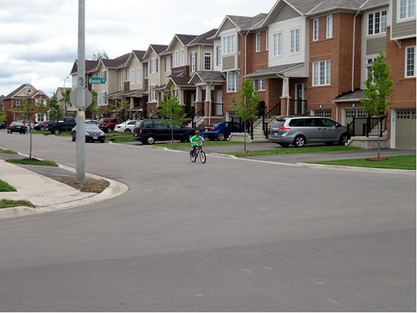 A row of townhouses in one of the newer surveys in the Meadowlands, adding density, income variation, and (here) a little street life to the neighbourhood