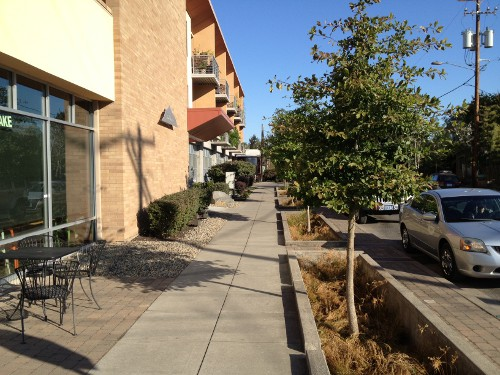 Beautiful sidewalks with micro-patios, street trees and curbside parking