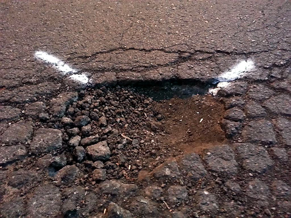 Pothole marked for filling (RTH file photo)