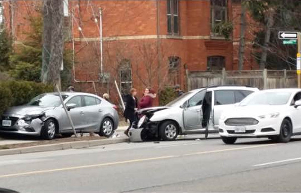 Car sitting across Queen Street sidewalk on march 28, 2018 (Image Credit: Tom Flood)