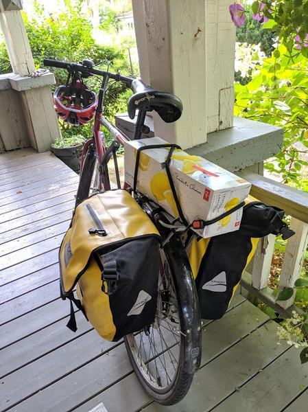 Case of soda strapped to bike rack