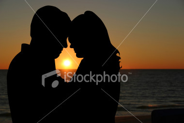 The silhouetted couple on the beach: always in stock