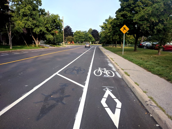 Buffer on left side of bike lane