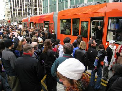 Crowds gather for the inauguration of Seattle's South Lake Union Streetcar (Image Credit: Flickr)