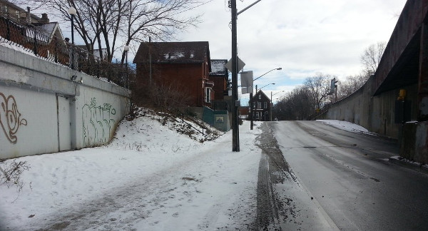 Snow-covered bike lane and sidewalk on Young Street west of Wellington (Image Credit: Ryan McGreal)