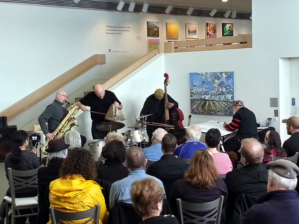 Sonoluminesence Trio: from left, David Mott on baritone saxaphone, Jesse Stewart on percussion and William Parker on Bass, plus artist in residence Jeff Schlanger painting the show