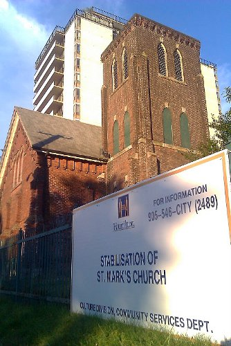 Sign in front of St. Mark's Church at Bay and Hunter announcing Stabilization plan