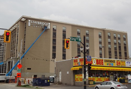 The sign goes up on the side of the Staybridge Suites hotel at Caroline and Market (RTH file photo)